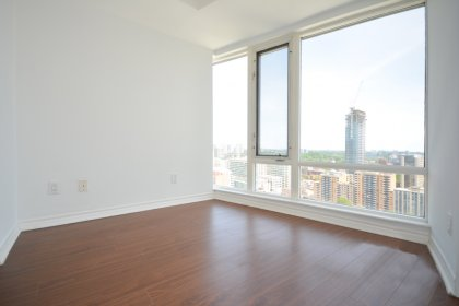 Study / Den (Can Be Used As A 2nd Bedroom) Area With Laminate Flooring & Privacy Sliding Doors Facing Unobstructed East City Views.