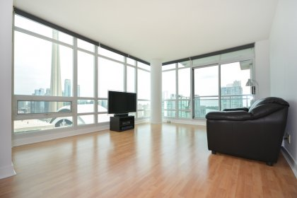 Bright Floor-To-Ceiling Wrap Around Windows With Laminate Flooring Throughout Facing Stunning Unobstructed C.N. Tower & Lake Views.