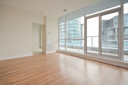 Bright Floor-To-Ceiling Windows With Laminate Flooring Throughout The Living Areas & 2 Walk-Outs To The Huge Terrace Facing C.N. Tower Views.
