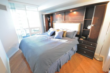 Spacious King Sized Bedroom With Hardwood Flooring, A Large Walk-In Closet & Semi Ensuite Access.