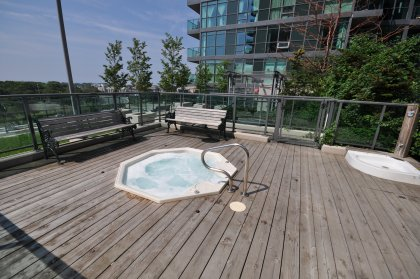 Roof Top Outdoor Tanning Deck, BBQ's & Jacuzzi.