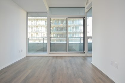 Living / Dining Areas With Bright 9� Floor-To-Ceiling Windows, A Smooth Ceiling & Laminate Flooring Throughout.