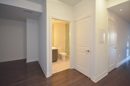 Suite Foyer With Upgraded Gleaming Hardwood Flooring Throughout.