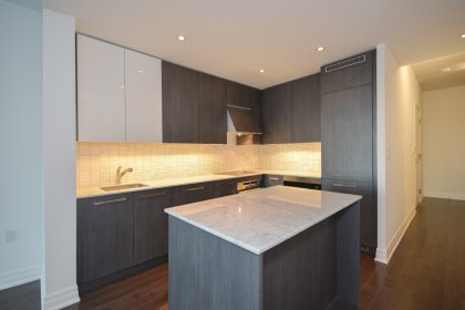 Designer Munge Leung Kitchen Cabinetry With Upgraded Built-Ins, Extended Upper Cabinets, Miele Stainless Steel Appliances & Marble Counters Tops.