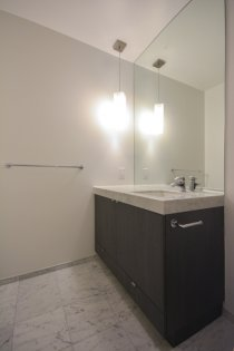 A Spacious Sized Master Bedroom With A 4-Piece Ensuite, Upgraded Marble Throughout Including Upgraded Full Sized Mirror.