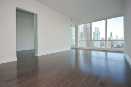 Bright Floor-To-Ceiling Windows With Upgraded Gleaming Hardwood Flooring & A Smooth Ceiling Throughout Facing Unobstructed City Views.