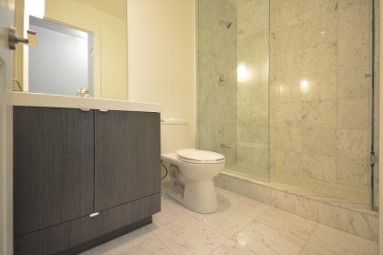 Main Bath With A 3-Piece & A Frameless Glass Stand-Up Shower, Upgraded Marble Throughout Including An Upgraded Full Sized Mirror.