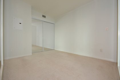 Spacious Sized Master Bedroom With Glass Sliding Doors & Mirrored Closets.