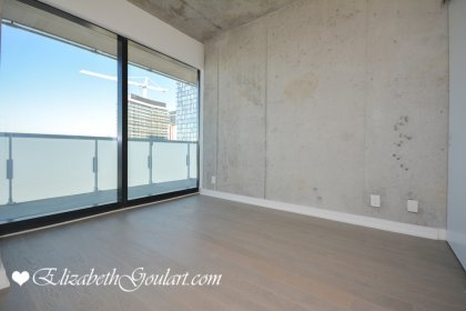 Spacious Sized Master Bedroom With A Frosted Glass Privacy Door & A Large Closet.