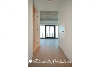 Suite Foyer With Hardwood Flooring Throughout.