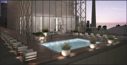 Outdoor Roof Top Pool With A Lounge & Tanning Deck.