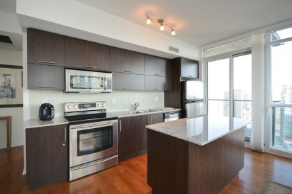 Designer Kitchen Cabinetry With Upgraded Stainless Steel Appliances, Granite Counter Tops, An Undermount Sink, Tile Backsplash & A Centre Island.
