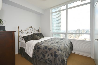2nd Bedroom With A Large Window Facing C.N. Tower Views.
