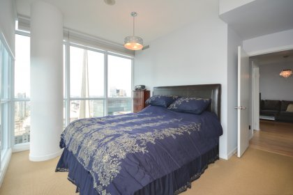 A Spacious Master Bedroom With 4-Piece Ensuite, Walk-In Closet, Remote Controlled Automated Blinds With Wrap Around Windows Facing C.N. Tower Views.