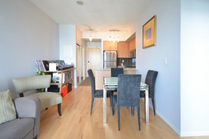 Open Concept Living & Dining Areas With Upgraded Lighting Fixtures / Dimmers & Hardwood Flooring Facing C.N. Tower Views.