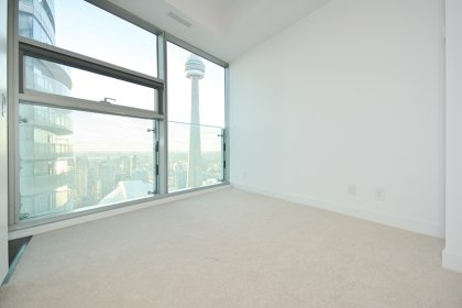 A Spacious Sized Master Bedroom With A 3-Piece Ensuite, Mirrored Closets & C.N. Tower Views.