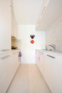 Designer Kitchen Cabinetry With Upgraded Built-Ins, Miele Stainless Steel Appliances, Marble Counters Tops, An Undermount Sink & Mosaic Tumbled Marble