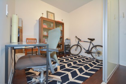 A Separate Den (Can Be Used As A Home Office / 2nd Bedroom) Area With Hardwood Flooring & Frosted Glass Sliding Doors.