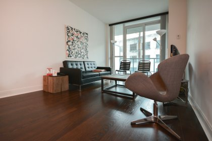 Living & Dining Area With Bright 9' Floor-To-Ceiling Windows With Gleaming Hardwood Flooring Throughout.
