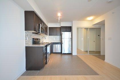 Designer Kitchen Cabinetry With Stainless Steel Appliances, Granite Counter Tops, An Undermount Sink & Tiled Backsplash.