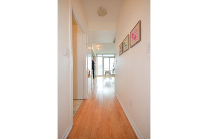 Suite Foyer With Hardwood Flooring.