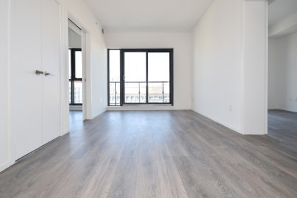 Bright Floor-To-Ceiling Windows With Laminate Flooring Throughout & A Huge Private Balcony Facing Unobstructed City Views.