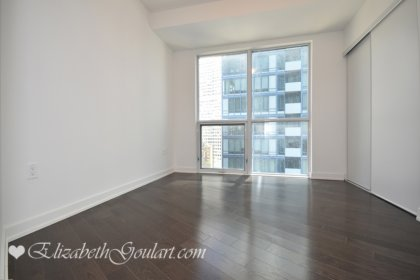 2nd Bedroom With A Large Closet & Gleaming Hardwood Flooring Throughout.