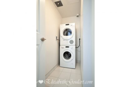 Large Laundry Area With Ample Storage.