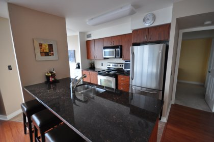 Granite Counter Tops With Under Mount Sink, Stainless Steel Appliances & Breakfast Bar.