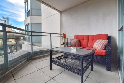 A Cozy Balcony Facing C.N. Tower Views.