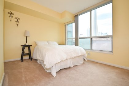 A Spacious Sized Master Bedroom With A Large Closet & A Large Window Facing The C.N. Tower.