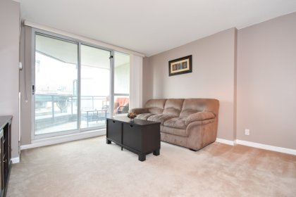 Bright Floor-To-Ceiling Windows With Broadloom Carpeting Throughout & A Cozy Balcony Facing C.N. Tower Views.