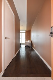Suite Foyer With Gleaming Hardwood Flooring & A Large Closet.
