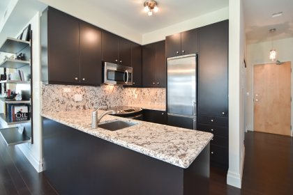 A Gorgeous Gourmet Designer Kitchen With Extended Cabinetry, Stainless Steel Appliances, Granite Counter Tops & Backsplash & An Undermount Sink.