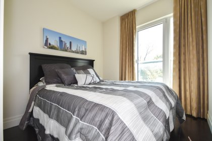 2nd Bedroom With A Pocket Door, Gleaming Hardwood Flooring & A Juliette Balcony Facing Park Views.