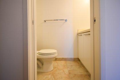 Powder Room With A 2-Piece & Pocket Door.