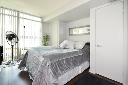 A Spacious Sized Master Bedroom With Double Closets & Laminate Flooring Throughout.