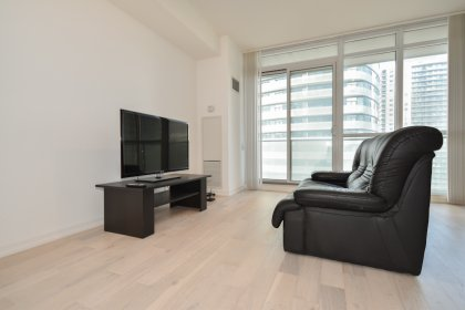 Living & Dining Areas With Bright Floor-To-Ceiling Windows & Hardwood Flooring Throughout Including Balcony C.N. Tower Views.