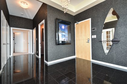 Suite Foyer With Imported Designer Wall Coverings & Lighting Fixtures.