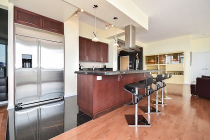 A Gorgeous Designer Gourmet Entertaining Kitchen With Upgraded Stainless Steel Appliances, Granite Counter Tops, Undermount Sink & A Breakfast Bar.