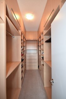 Master Bedroom Walk-In Closet With Custom Cabinetry Organizers.