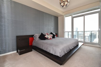 A Spacious Sized Master Bedroom With A 5-Piece Ensuite Including A Stand-Up Shower & Separate Jacuzzi Soaker Tub, Walk-In Closet & A Walk-Out Balcony.