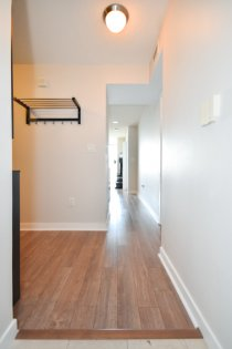 Suite Foyer With Laminate Flooring Throughout.