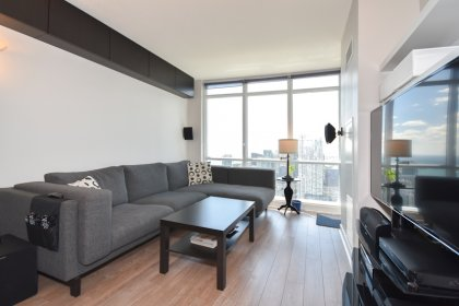 Bright Floor-To-Ceiling Windows With Laminate Flooring Throughout Facing Unobstructed Park & Lake Views.