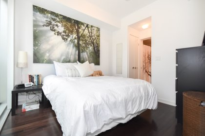 A Spacious Sized Master Bedroom With A Semi-Ensuite, Double Closets & Hardwood Flooring.