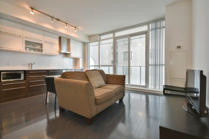 Living & Dining Areas With Bright 9Ft. Floor-To-Ceiling Windows With Hardwood Flooring Throughout.