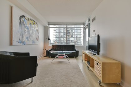 Living & Dining Areas With Bright Windows & Laminate Flooring Throughout The Living Areas.