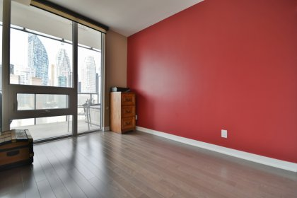 2nd Bedroom With A Large Closet, Pocket Door & Large Window Facing C.N. Tower Views.
