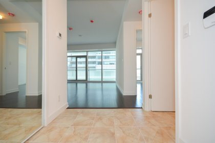 Suite Foyer With Mirrored Closet.