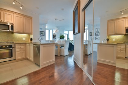 Suite Foyer With Gleaming Hardwood Flooring & A Mirrored Closet.